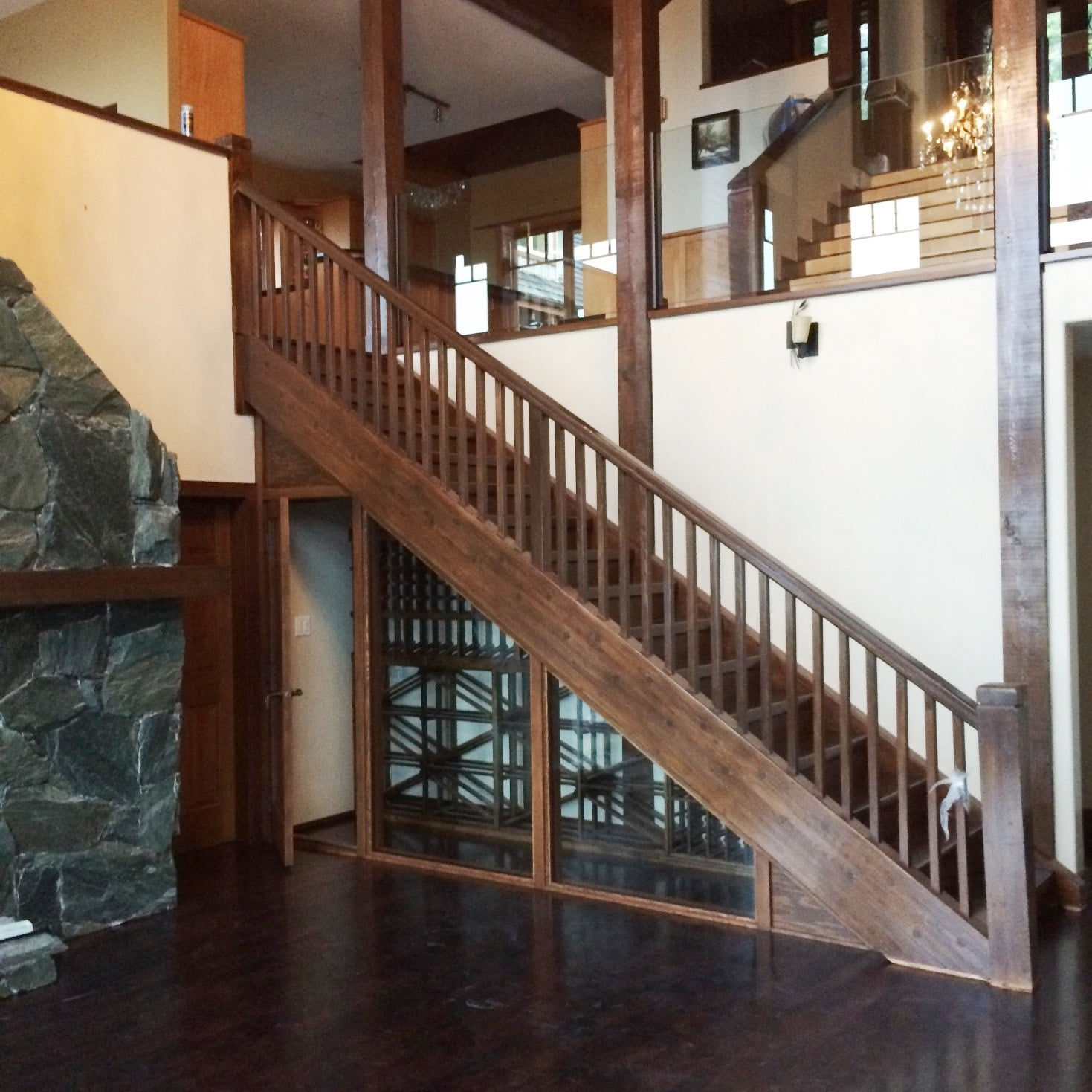 Custom Home Wine Cellar Under the Stairs with Knotty Alder Wine Racks